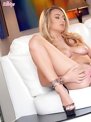 Hot Natalia Starr in a sexy clothes enjoys teasing herself